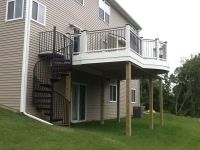 Curved deck in Trex, Transcend rails with Vintage Lantern top cap Spriral staircase