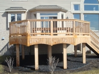 DECK POST WRAPPED IN CEDAR TRIM
