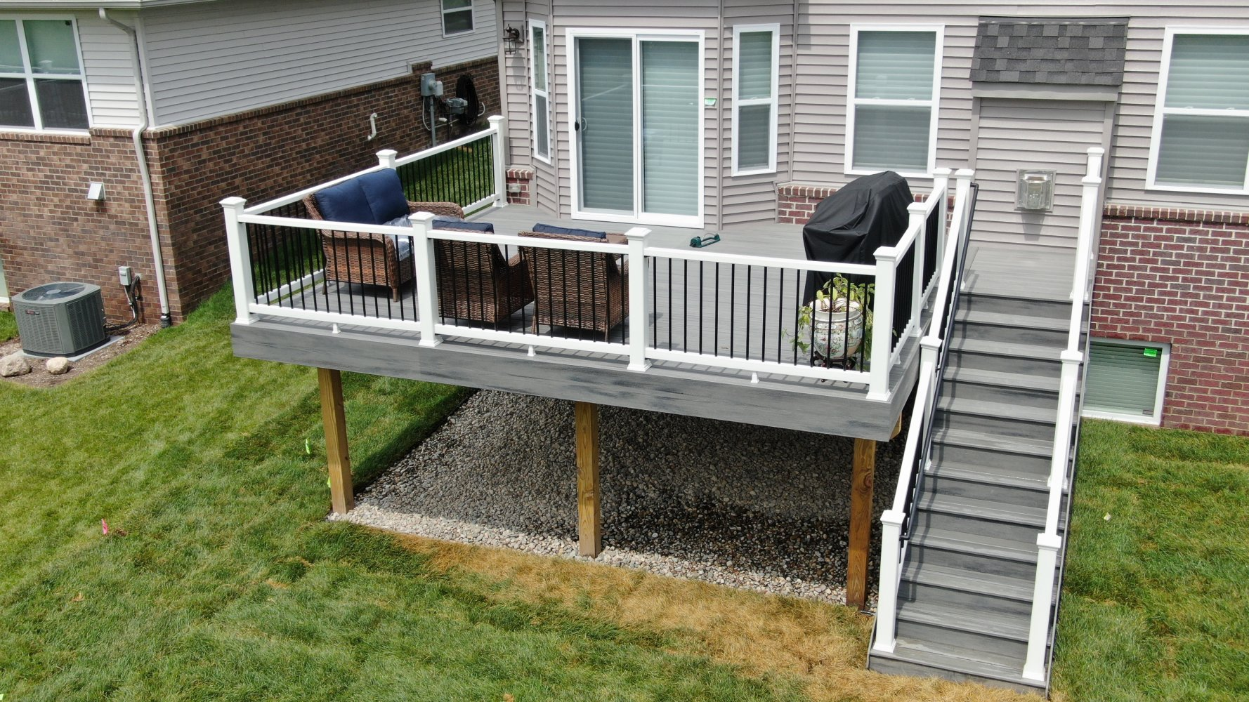 Rocky-harbor-with-White-Trandscend-rails-black-balusters